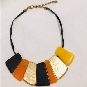 Kenneth Cole Necklace mix of metal, lucite & wood.